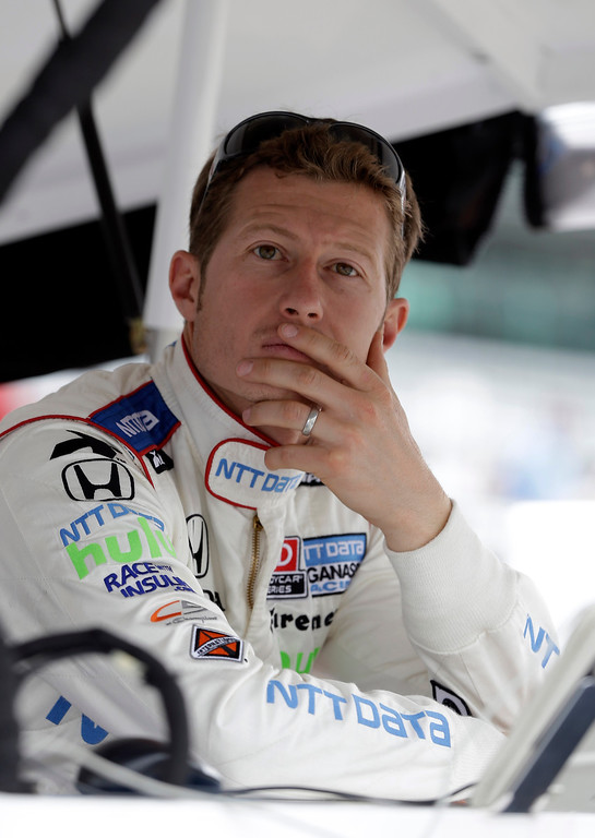 . Ryan Briscoe, of Australia, checks the scoring monitors as he waits to practice for the Indianapolis 500 auto race at the Indianapolis Motor Speedway in Indianapolis, Thursday, May 16, 2013. (AP Photo/Darron Cummings)