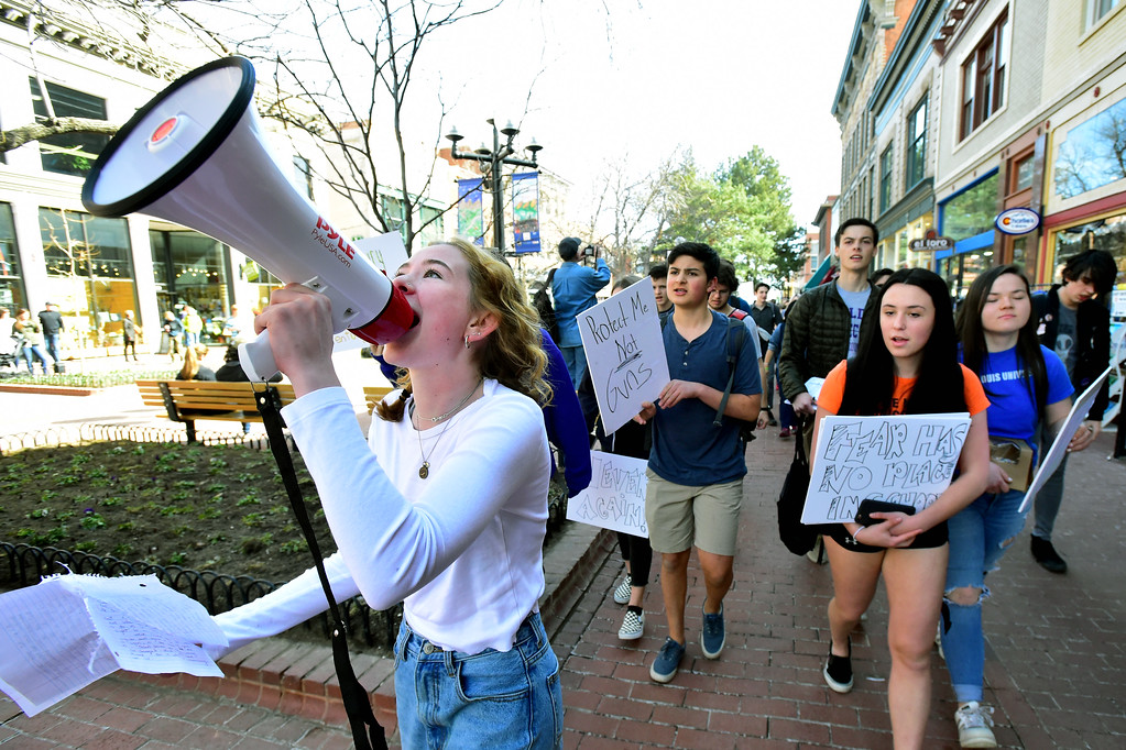 . Simone Leonard leads a group of students down the Pearl Street Mall during a walkout to protest gun violence at Boulder High School on Wednesday morning.  For more photos go to dailycamera.com Paul Aiken Staff Photographer March 14, 2018.