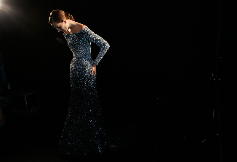 . A model waits backstage prior to the Elie Saab Fall Winter 2014-15 Haute Couture fashion collection, in Paris, Wednesday, July 9, 2014. (AP Photo/Thibault Camus)
