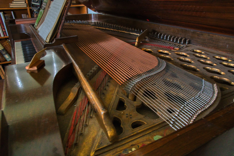Close-up image of the square grand piano  on display at the Durrell House