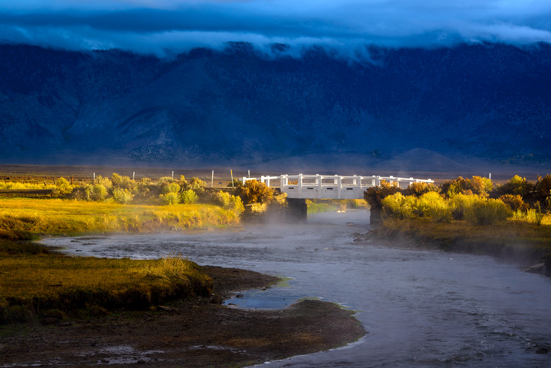 Bridge over Hot Creek on a cloudy day.