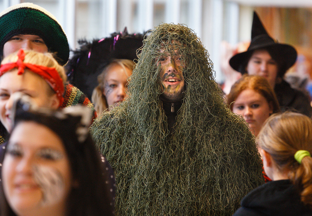 . Port Jervis High School seniors march through the school during the annual Halloween Parade at the school in Port Jervis, N.Y., on Thursday, Oct. 31, 2013. (AP Photo/Times Herald-Record/TOM BUSHEY)