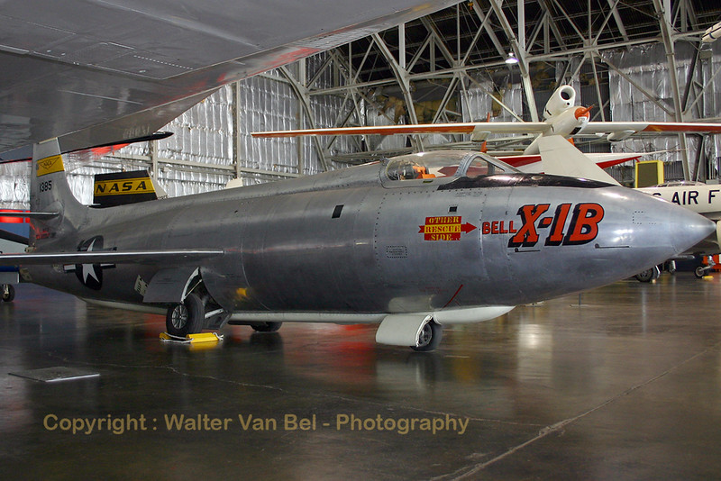 """The Bell X-1 (Bell Model 44) is a rocket engine–powered aircraft, designated originally as the XS-1, and was a joint National Advisory Committee for Aeronautics–U.S. Army Air Forces–U.S. Air Force supersonic research project built by Bell Aircraft. Conceived during 1944 and designed and built in 1945, it achieved a speed of nearly 1,000 miles per hour (1,600 km/h; 870 kn) in 1948. A derivative of this same design, the Bell X-1A, having greater fuel capacity and hence longer rocket burning time, exceeded 1,600 miles per hour (2,600 km/h; 1,400 kn) in 1954.The X-1, piloted by Chuck Yeager, was the first manned airplane to exceed the speed of sound in level flight and was the first of the X-planes, a series of American experimental rocket planes (and non-rocket planes) designed for testing new technologies. The X-1B was one of a series of rocket-powered experimental airplanes designed to investigate supersonic flight problems. The X-1B's flight research primarily related to aerodynamic heating and the use of small """"reaction"""" rockets for directional control.  The X-1B made its first powered flight in October 1954. A few months later, the U.S. Air Force transferred the X-1B to the NACA (National Advisory Committee for Aeronautics), predecessor to NASA (National Aeronautics and Space Administration), which conducted the heating and control tests. The X-1B tests played an important role in developing the control systems for the later X-15.  On test missions, the X-1B was carried under a """"mother"""" airplane and released between 25,000-35,000 feet. After release, the rocket engine fired under full throttle for less than five minutes. After all fuel (an alcohol-water mixture) and liquid oxygen had been consumed, the pilot glided the airplane to earth for a landing.  The X-1B made its last flight in January 1958, and it was transferred to the museum a year later.  TECHNICAL NOTES: Engine: Reaction Motors XLR-11-RM-6 four-chamber rocket engine of 6,000 lbs. thrust Maximum speed: """