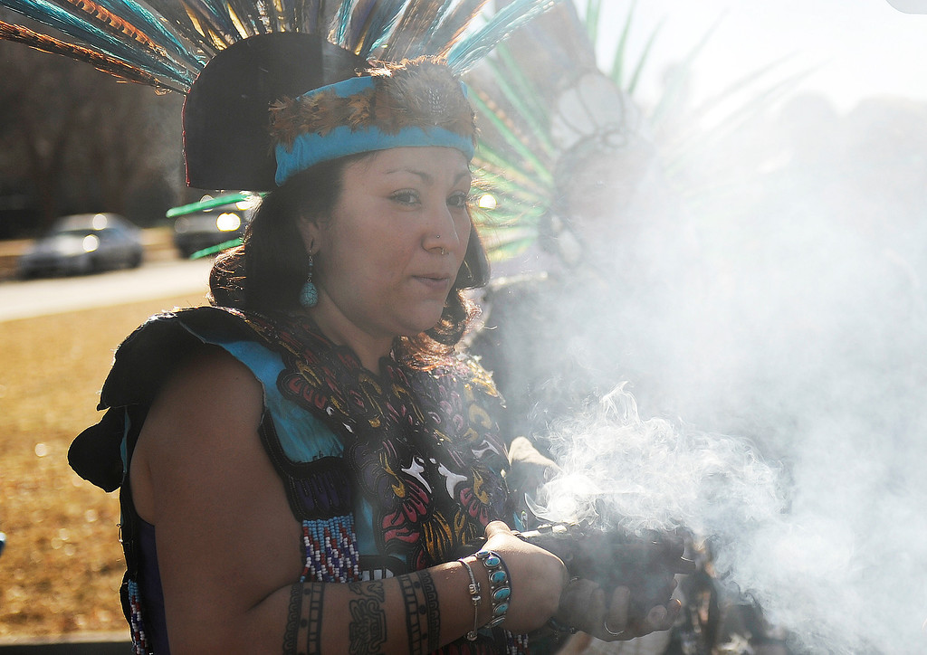 . Desiree Ortega-Stange of the Aztlan Nation in Denver holds smoking incense  as she joins in the  Martin Luther King Jr. Marade  as it winds out of City Park on it\'s way downtown.  The marade, march/parade,  started at the MLK statue in the City Park  on Monday, January 21, 2013.   (Photo By Cyrus McCrimmon / The Denver Post)
