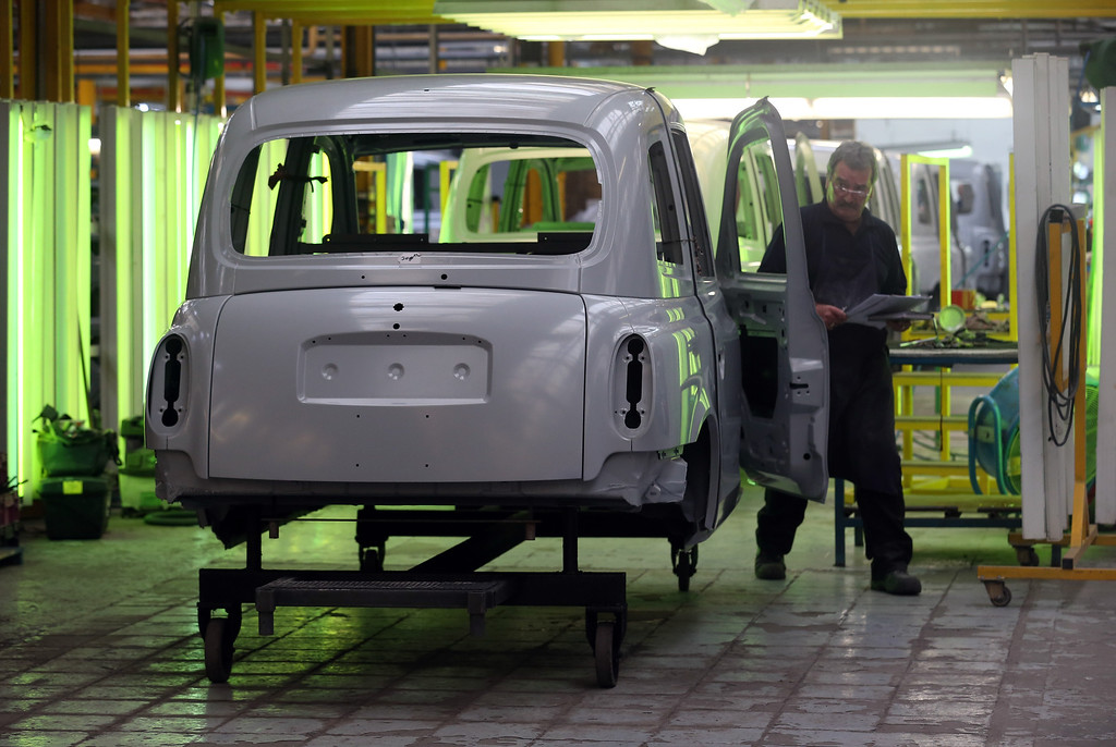 . A worker  on the assembly line works on a TX4 (Euro 5) London Taxi inside the factory of the London Taxi Company on September 11, 2013 in Coventry, England.   (Photo by Matt Cardy/Getty Images)