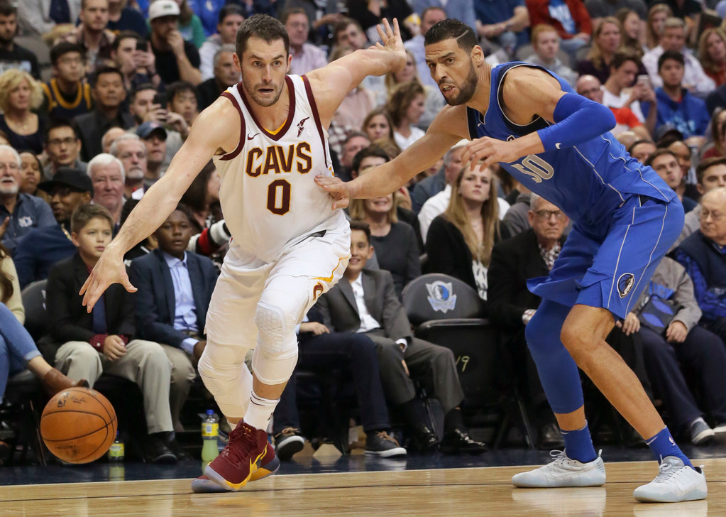. Cleveland Cavaliers forward Kevin Love (0) drives past Dallas Mavericks center Salah Mejri (50) during the first half of an NBA basketball game in Dallas, Saturday, Nov. 11, 2017. (AP Photo/LM Otero)