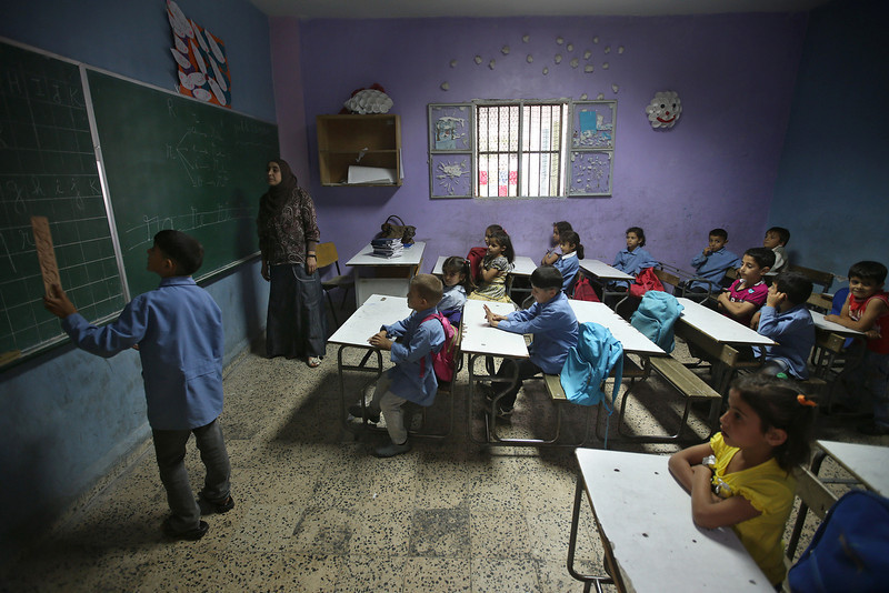 . In this picture taken on Thursday, May 29, 2014, Syrian refugee students attend a French lesson as they sit in a classroom in a Lebanese public school where only Syrian students attend classes in the afternoon, in Kaitaa village in north Lebanon. (AP Photo/Hussein Malla)