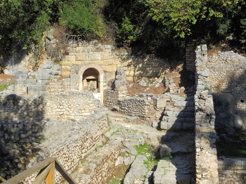 I think this may be the remains of a small Christian church.  Several have been excavated at Butrint.