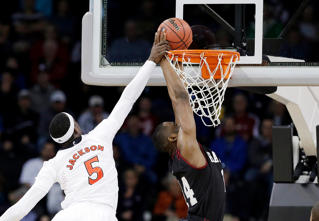 . Cincinnati\'s Justin Jackson (5) tries to stop a shot by Harvard\'s Steve Moundou-Missi in the first half during a second-round game of the NCAA college basketball tournament in Spokane, Wash., Thursday, March 20, 2014. (AP Photo/Elaine Thompson)