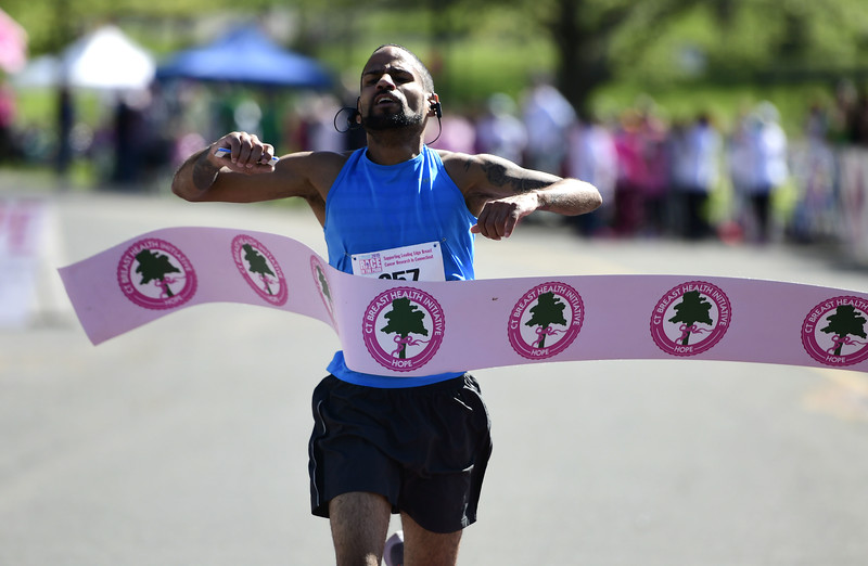 5/11/2019 Mike Orazzi | Staff Mario Vazquez takes first place in the 5K during the 16th annual Race in The Park held Saturday in New Britain.
