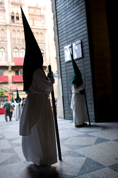 Hooded penitents inside Seville's cathedral, Holy Week 2008