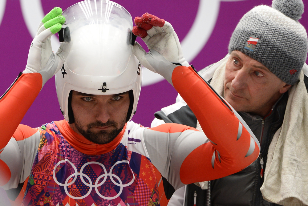 . Poland\'s Maciej Kurowski competes during the Men\'s Luge Singles run two at the Sliding Center Sanki during the Sochi Winter Olympics on February 8, 2014.  (LIONEL BONAVENTURE/AFP/Getty Images)