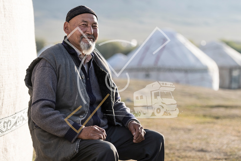 Kyrgyz man sitting next to his yurt at the World Nomad Games in 2018