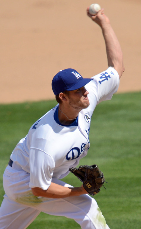. Clayton Kershaw delivers a pitch against the San Francisco Giants on opening day at Dodger Stadium April 1, 2013.(Andy Holzman/Staff Photographer)