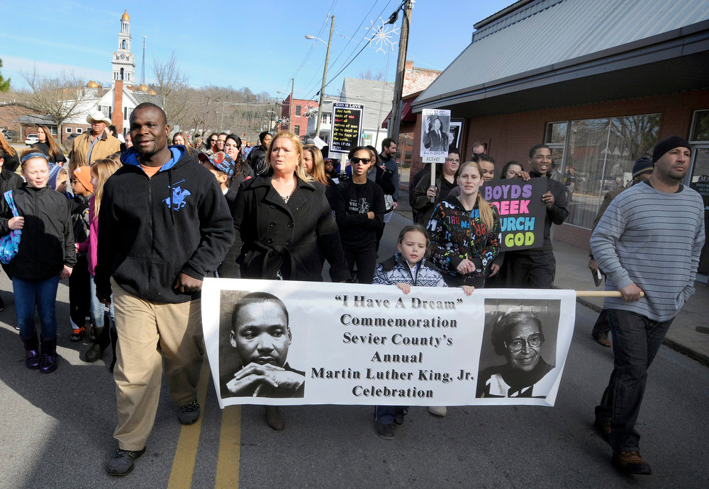 Description of . Participants head down Court Avenue during the 8th annual Martin Luther King Day Celebration in Sevierville, Tenn. on Monday Jan. 21, 2013. (AP Photo/The Mountain Press, Curt Habraken)