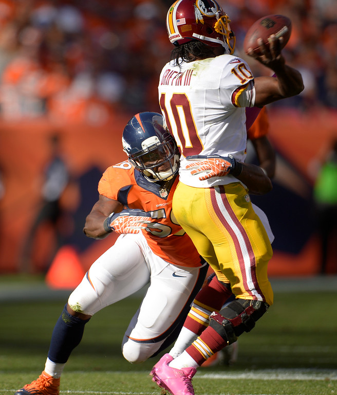 . Washington Redskins quarterback Robert Griffin III (10) is hit by Denver Broncos outside linebacker Danny Trevathan (59) in the second quarter.  (Photo by Joe Amon/The Denver Post)