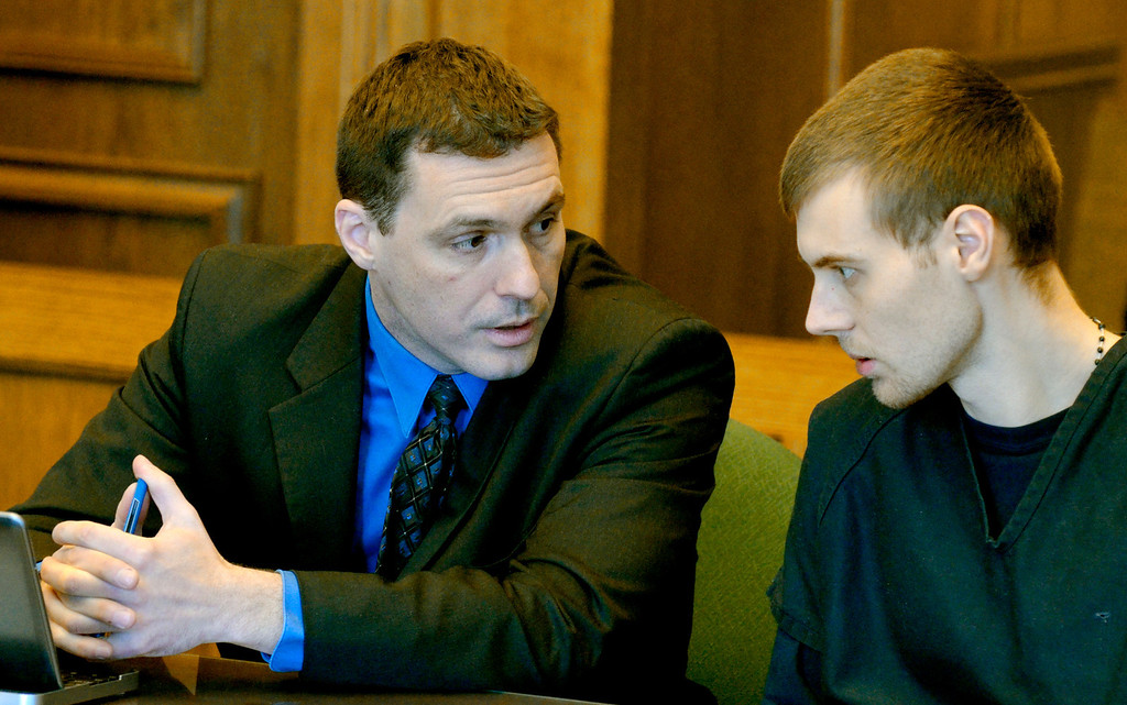 . Jeff Forman/JForman@News-Herald.com Nathaniel Brown, right, talks with his lawyer Matthew Bangerter before Brown\'s re-senetencing in Lake County Common Pleas Court March 3 for the 2011 murder of William Andrew Fayne Putzbach.