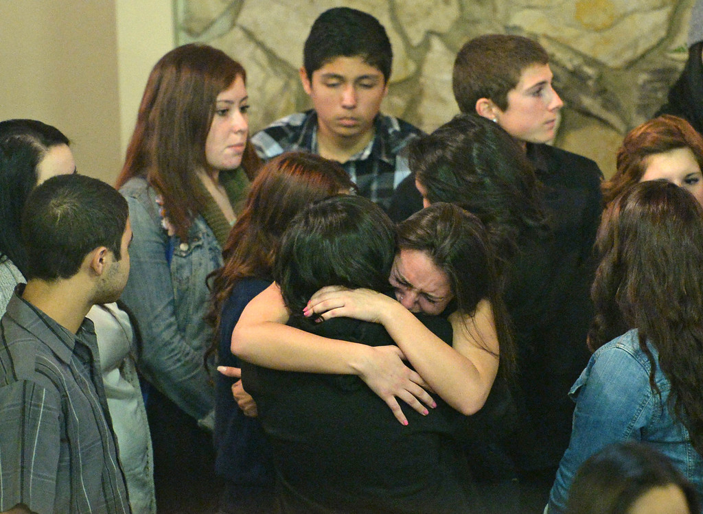 . Funeral services were held for Torrance High student Valentina d\'Alessandro Wednesday, December 11, 2013, in Torrance, CA.  Friends console each other after the funeral. D\'Alessandro was killed in a traffic collision in Wilmington Saturday. Photo by Steve McCrank/DailyBreeze
