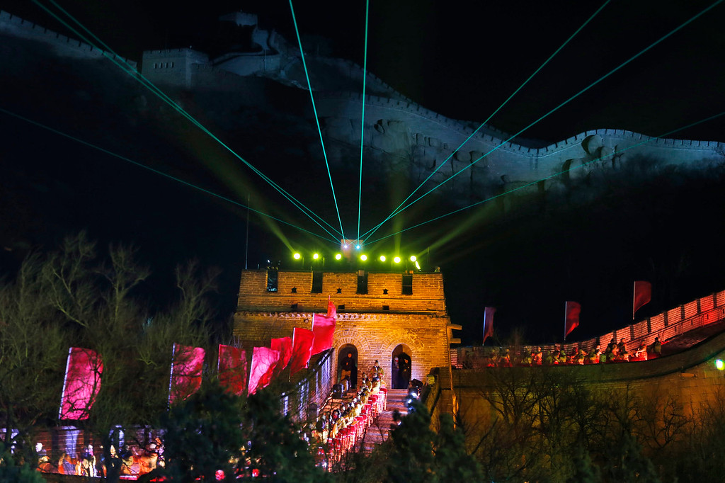 . Laser lights shoot from a tower during a New Year\'s Eve count down to 2014 held at the Great Wall of China in Beijing, China, Tuesday, Dec. 31, 2013. (AP Photo/Ng Han Guan)