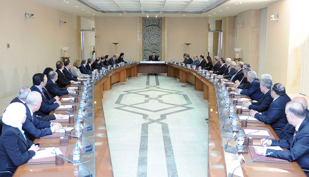 Description of . Syria's President Bashar al-Assad (C) heads a cabinet meeting in Damascus,in this handout photograph distributed by Syria's national news agency SANA on February 12, 2013. REUTERS/SANA/Handout
