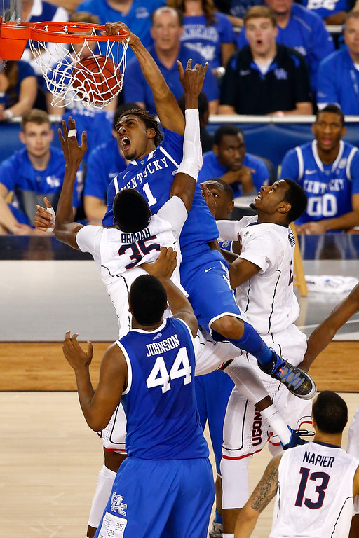 . ARLINGTON, TX - APRIL 07: James Young #1 of the Kentucky Wildcats dunks over Amida Brimah #35 of the Connecticut Huskies during the NCAA Men\'s Final Four Championship at AT&T Stadium on April 7, 2014 in Arlington, Texas.  (Photo by Tom Pennington/Getty Images)