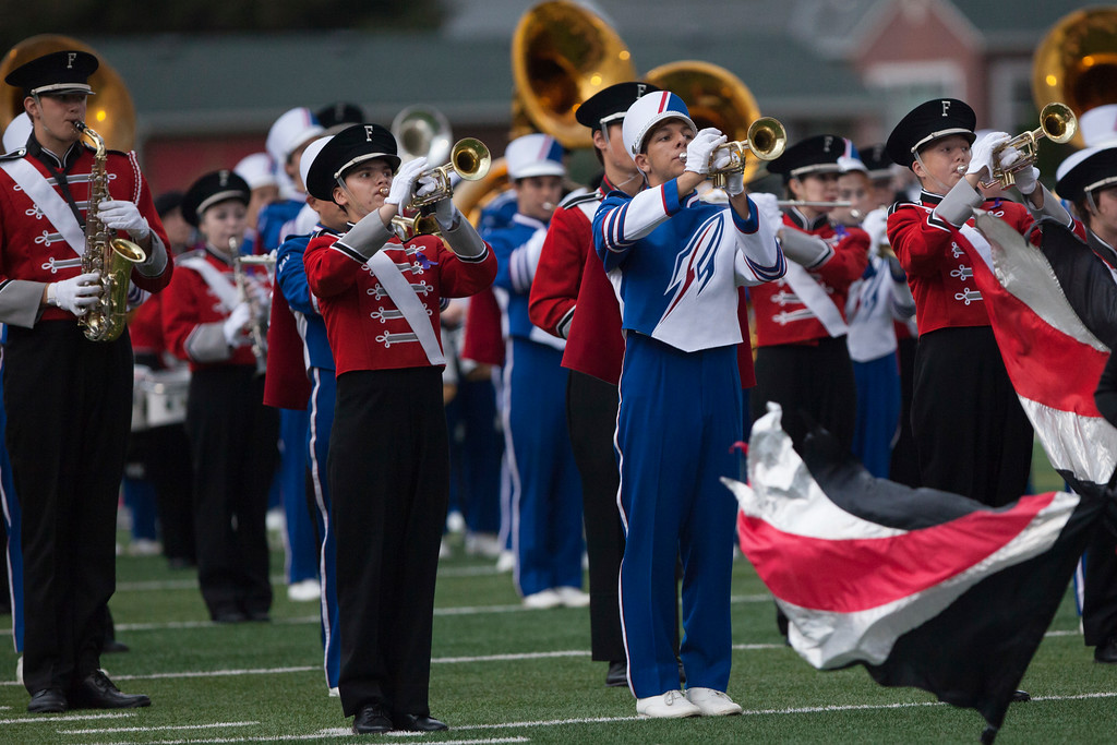 . Jen Forbus - The Morning Journal<br> The Bay and Fairview bands combine to play the National Anthem before the game on Sept. 7.