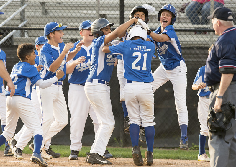 08/29/19  Wesley Bunnell   Staff  The McCabe-Waters Astros vs the Forrestville Dodgers 3-0 at Breen Field on in the final game on Thursday night at Breen Field for the City Series championship. Aiden Lopez (21) is mobbed by teammates after hitting a game tying home run including Xavier Malanguin (23), R.