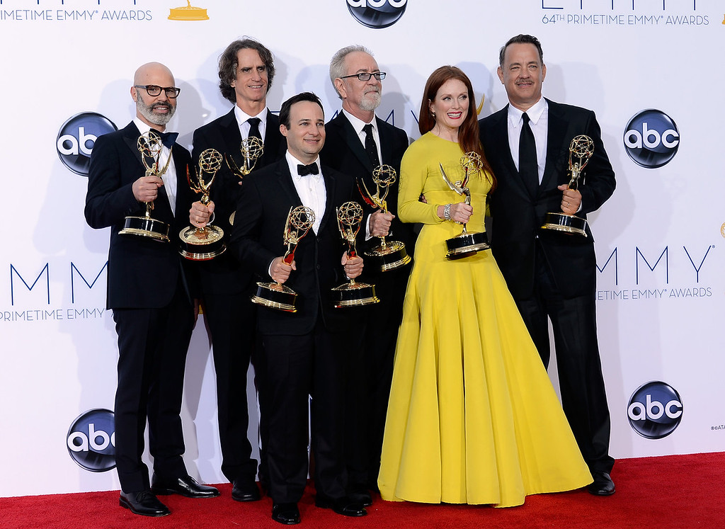 """. (L-R) Producer Steven Shareshian, director Jay Roach, writer Danny Strong, producer Gary Goetzman, actress Julianne Moore, and producer Tom Hanks, winners Outstanding Miniseries or TV Movie for \""""Game Change,\"""" pose in the press room during the 64th Annual Primetime Emmy Awards at Nokia Theatre L.A. Live on September 23, 2012 in Los Angeles, California.  (Photo by Kevork Djansezian/Getty Images)"""