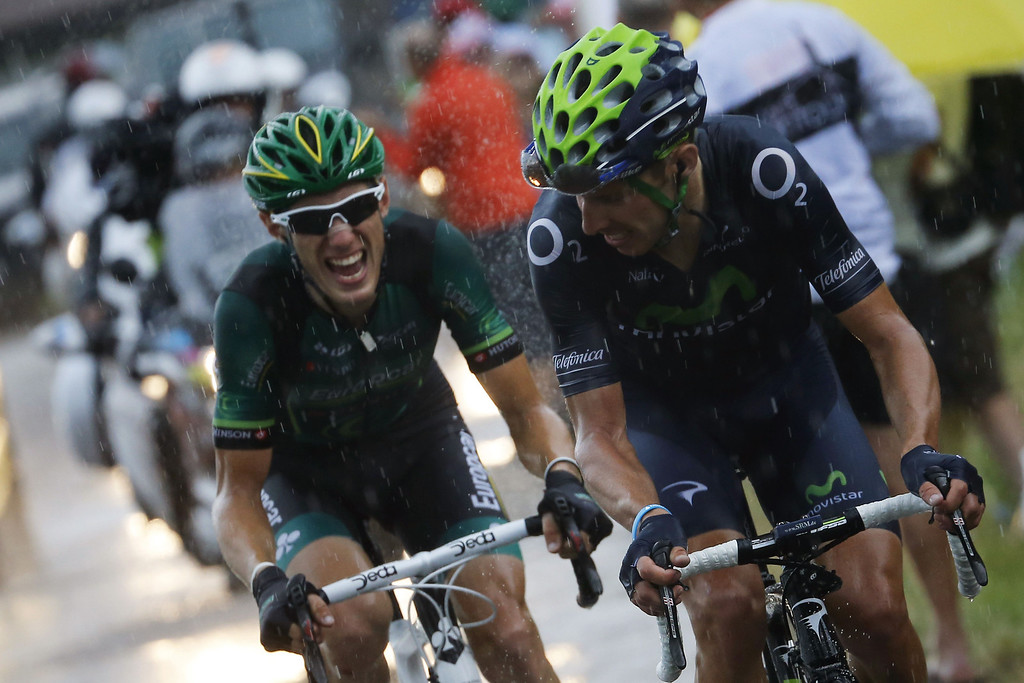 . Portugal\'s Rui Alberto Costa (R) rides in a heavy rain ahead of France\'s Pierre Rolland during the 204.5 km nineteenth stage of the 100th edition of the Tour de France cycling race on July 19, 2013 between Bourg-d\'Oisans and Le Grand-Bornand, French Alps.  AFP PHOTO / JEFF  PACHOUD/AFP/Getty Images