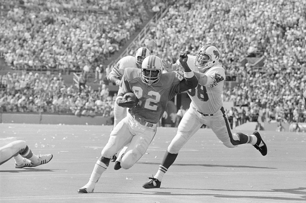 ". Miami Dolphins Eugene ""Mercury\"" Morris (22) scores the winning touchdown Sunday, Oct. 23, 1972 in the Orange Bowl against Buffalo Bills as the Dolphins, in their 24-23 win, remain pro football only unbeaten team this season. Trying to stop Morris on his 15 yard jaunt in the fourth quarter is Buffalo\'s Mike Stratton. (AP Photo/Jim  Bourdier)"