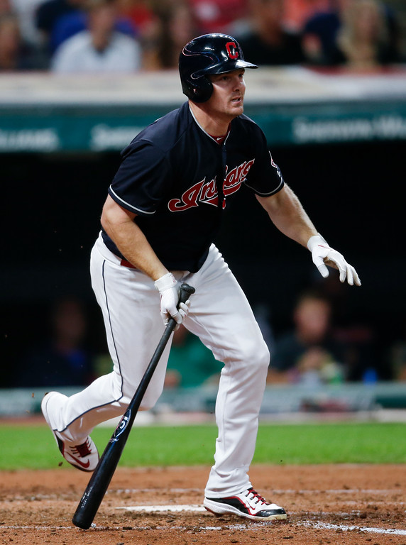 . Cleveland Indians\' Jay Bruce hits a RBI single off Minnesota Twins relief pitcher Tyler Duffey during the third inning in a baseball game, Tuesday, Sept. 26, 2017, in Cleveland. (AP Photo/Ron Schwane)