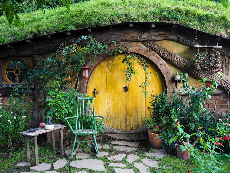 Yellow hobbit hole at Hobbiton