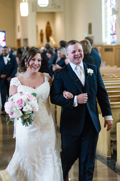 Emily & Stevie, right after being pronounced husband and wife: LOCATION: St. Francis of Assisi 3615 Harford Rd. Baltimore, MD 21218 /// Bridal Gown: Elegant Touch Bridal // Make Up: Flawless Finish by Cassie // Hair: Candace Bowers