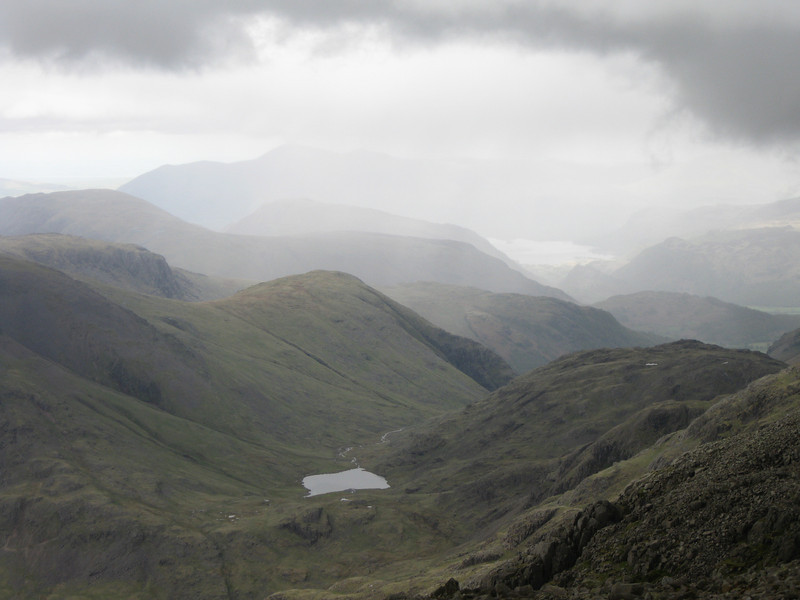 Styhead Tarn in the foreground with Derwentwater further in the distance