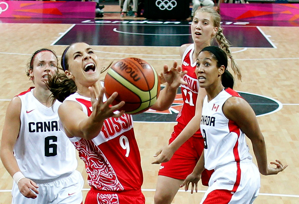 . Russia\'s Becky Hammon (9) reacts as she scrambles for the ball against Canada during the women\'s group B basketball game at the 2012 Summer Olympics, Saturday, July 28, 2012. (AP Photo/Sergio Perez, Pool)