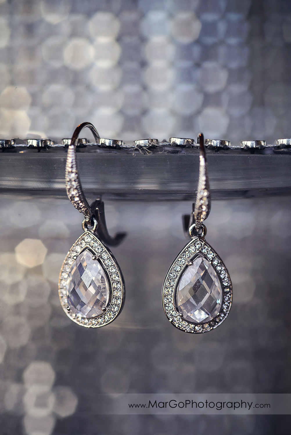 bridal earrings on silver background