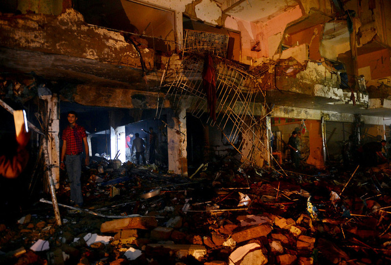 . Pakistani rescuers search for victims at the site of the bomb blast in Karachi on March 3, 2013. A bomb attack in Pakistan\'s largest city Karachi on Sunday killed at least 23 people, including women and children, and wounded 50 others, police said. ASIF HASSAN/AFP/Getty Images
