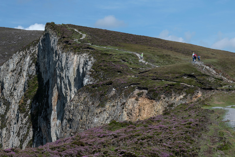 Tourists walking up a hill, Slieve League, County Donegal, Ireland
