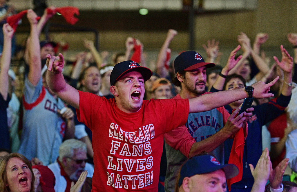. Cleveland Indians fan Zach Young gestures during a watch party for Game 7 of the baseball World Series between the Indians and the Chicago Cubs, outside Progressive Field, Wednesday, Nov. 2, 2016, in Cleveland. (AP Photo/David Dermer)