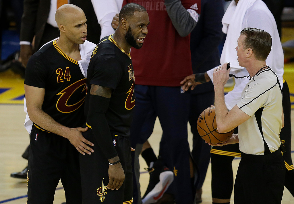 . Cleveland Cavaliers forward LeBron James, center, and forward Richard Jefferson (24) talk with referee Ed Malloy during the first half of Game 5 of basketball\'s NBA Finals between the Golden State Warriors and the Cavaliers in Oakland, Calif., Monday, June 12, 2017. (AP Photo/Ben Margot)