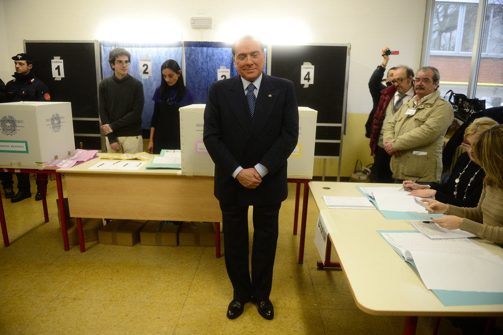 . Italian former Prime Minister Silvio Berlusconi poses after casting his ballot at a polling station on February 24, 2013 in Milan. Italians fed up with austerity went to the polls on Sunday in elections where the centre-left is the favorite, as Europe held its breath for signs of fresh instability in the eurozone\'s third economy.     OLIVIER MORIN/AFP/Getty Images