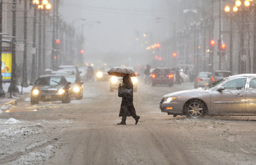 Description of . A pedestrian crosses the street as snow falls on March 5, 2013 in Chicago, Illinois. The worst winter storm of the season is expected to dump 7-10 inches of snow on the Chicago area with the worst expected for the evening commute.  (Photo by Brian Kersey/Getty Images)