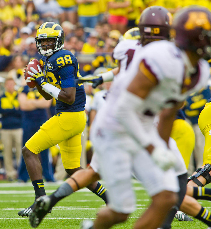 . Michigan quarterback Devin Gardner looks for an open receiver to throw a pass to during the second quarter. (AP Photo/Tony Ding)