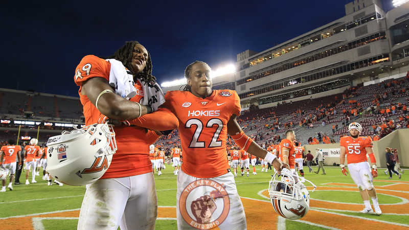 Tremaine and Terrell Edmunds pose in the endzone as the teams walk off the field. The Hokies defeated UNC 59-7. (Mark Umansky/TheKeyPlay.com)