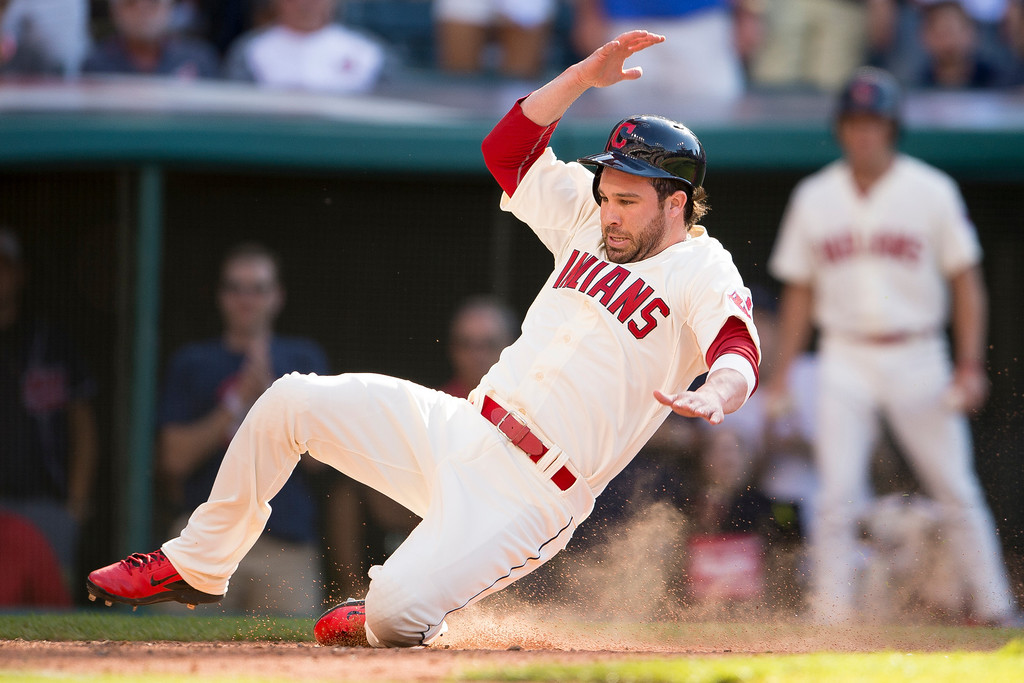 . CLEVELAND, OH - MAY 31: Jason Kipnis #22 scores the go-ahead run off a single by Mike Aviles #4 of the Cleveland Indians during the eighth inning against the Colorado Rockies at Progressive Field on May 31, 2014 in Cleveland, Ohio. (Photo by Jason Miller/Getty Images)