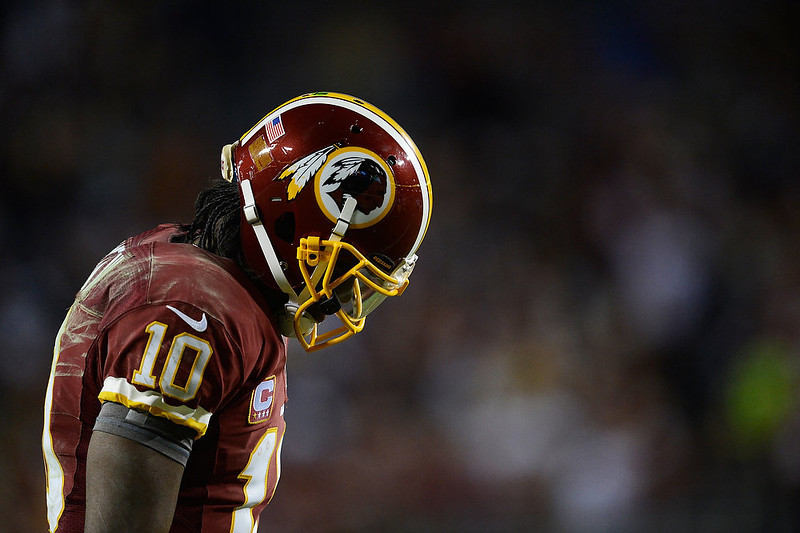 . Robert Griffin III #10 of the Washington Redskins reacts during their NFC Wild Card Playoff Game against the Seattle Seahawks at FedExField on January 6, 2013 in Landover, Maryland.  (Photo by Patrick McDermott/Getty Images)