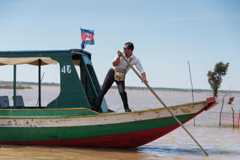 Man rowing tourboat in Tonle Sap lake, Kampong Phluk, Siem Reap, Cambodia
