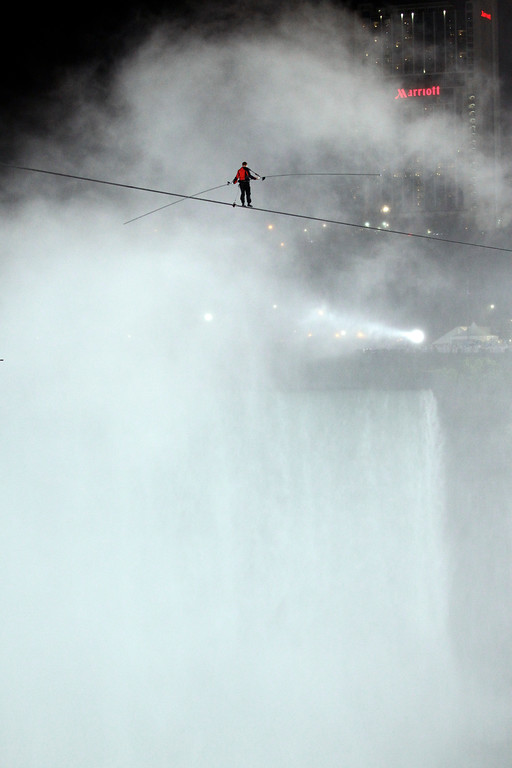. Nik Wallenda walks across Niagara Falls on a wire in Niagara Falls, N.Y., Friday, June 15, 2012. (AP Photo/David Duprey)