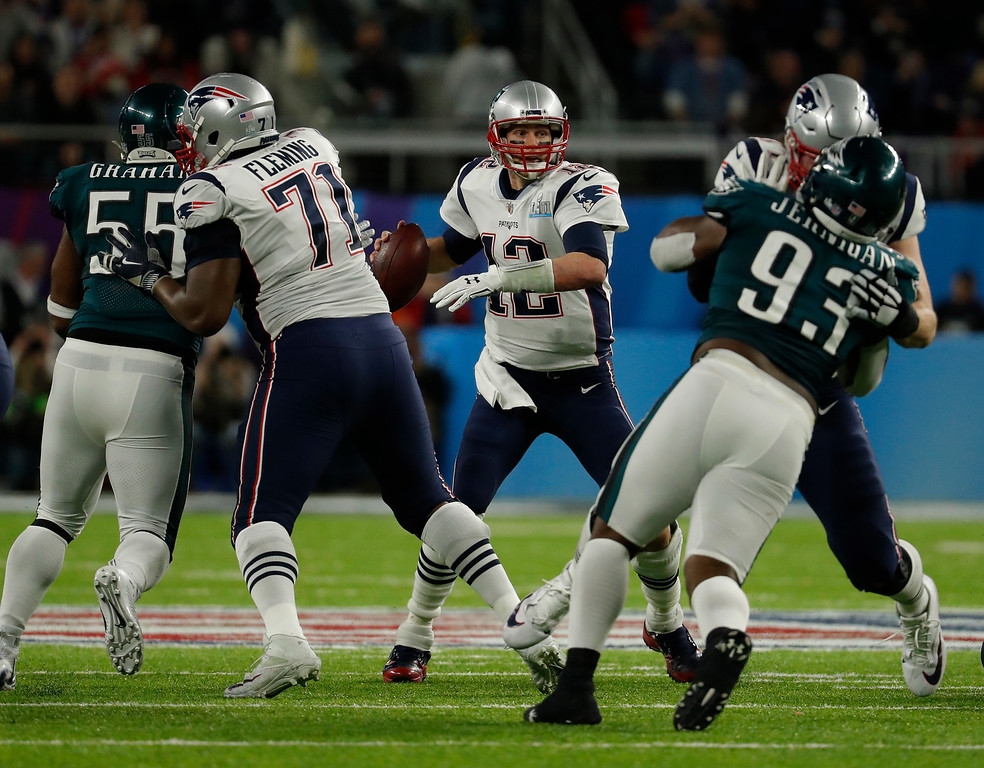 . New England Patriots quarterback Tom Brady (12) looks to pass, during the first half of the NFL Super Bowl 52 football game against the Philadelphia Eagles, Sunday, Feb. 4, 2018, in Minneapolis. (AP Photo/Charlie Neibergall)