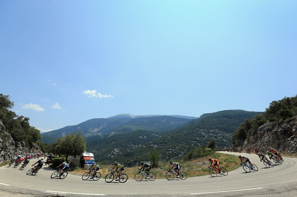 . The peloton winds through the hills with the Mount Ventoux in the background during stage sixteen of the 2013 Tour de France, a 168KM road stage from Vaison-la-Romaine to Gap, on July 16, 2013 in Vaison-la-Romaine, France.  (Photo by Doug Pensinger/Getty Images)